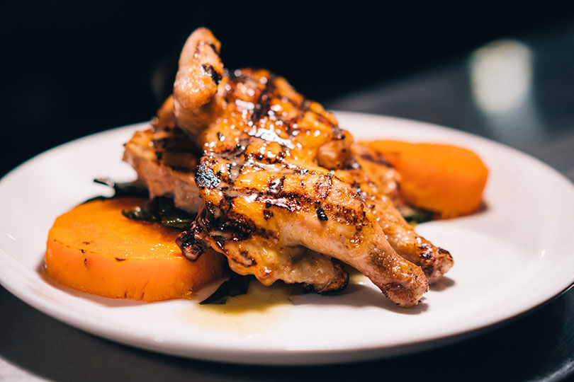 Plate of Grilled Cornish Hen with squash