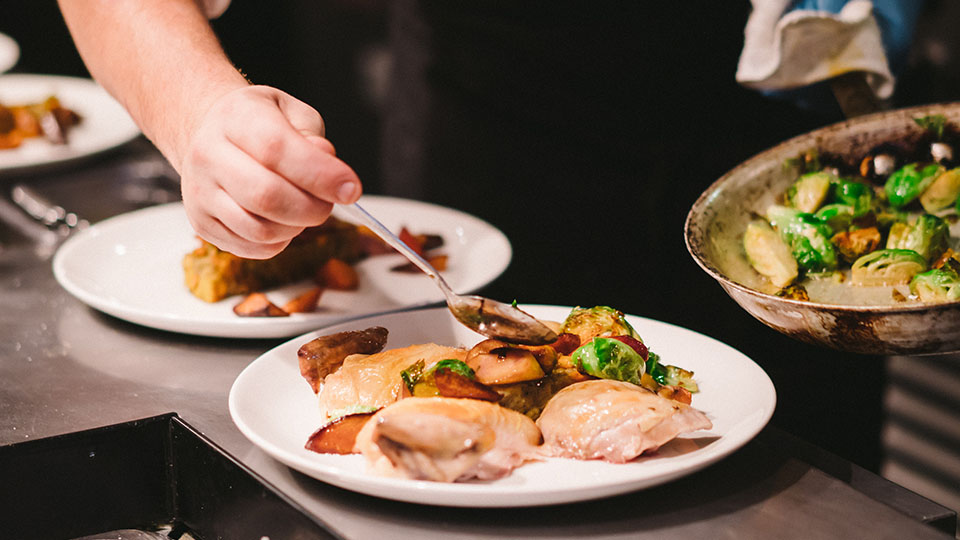 Chef putting food on a plate