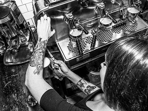 Girl making cappuccino